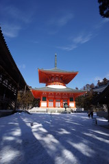 famous temple with snow and sunny sky.