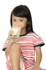 Cute Little Asian Girl Drinking Milk