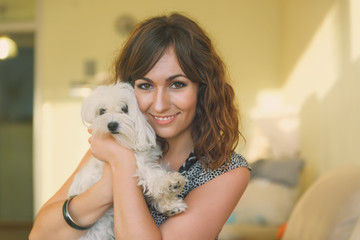 Portrait of Woman Hugging Small White Dog