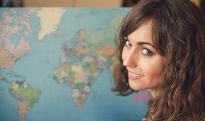 Woman with Map Looking over Shoulder at Camera