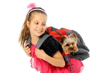 Happy bautiful schoolgirl going to school with puppy