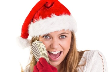 Festive blonde showing fan of dollars
