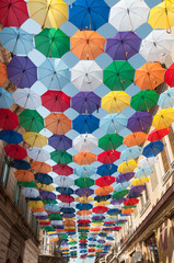 Street decorated with colored umbrellas