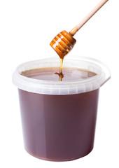 plastic bucket with honey