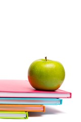 Green apple on notebooks
