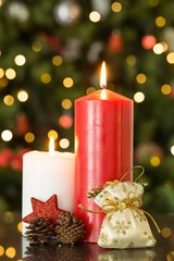 Focus on christmas candles and decorations