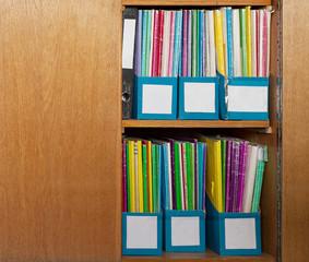 Colour file folders in office cupboard