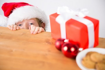 Child looking at christmas present