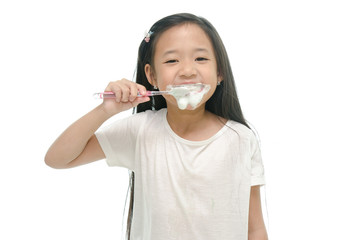 Little beautiful asian girl brushing teeth