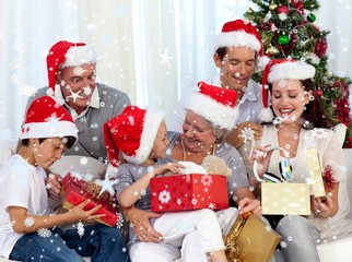 Composite image of family opening christmas presents at home