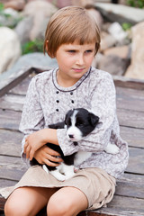 Little girl with the puppy