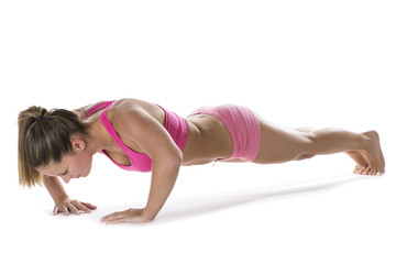 Fit young woman doing press-ups