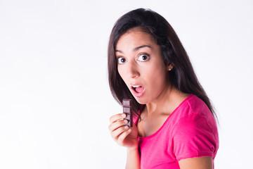 beautiful young woman eating chocolate guilty attitude