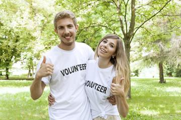 couple of teenagers volunteering