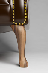 Closeup of wooden foot of a chair