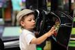 Child playing arcade game machine