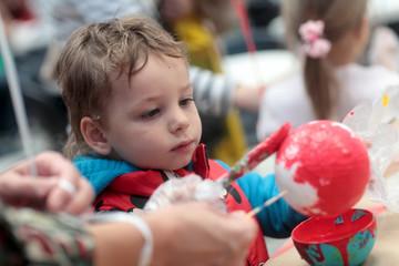 Child painting ball