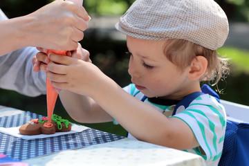 Kid coloring gingerbread