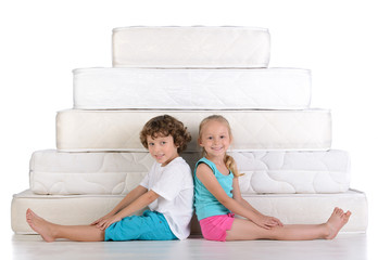 Children and many mattresses