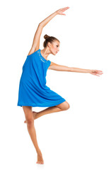 Young girl dancing in a blue dress