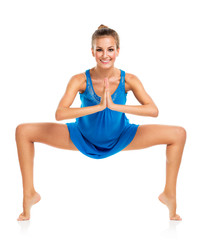 Young gymnast girl doing exercises