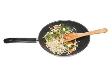 Stir fry vegetables in a wok