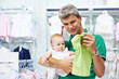 man and baby shopping clothes