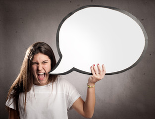 portrait of angry young girl holding a speech bubble
