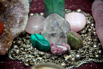 close  up of polished stones and crystals on alter