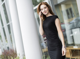 Young woman in front of office