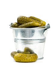 pickled cucumbers in a metal bucket isolated on white
