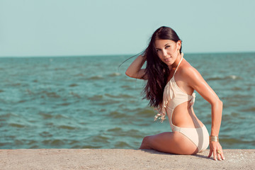 Girl sunbathing at the seaside