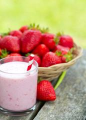 strawberry milk shake on wooden garden table