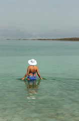 Woman in the water of the Dead sea Israel