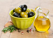 green and black olives in a green oil