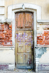 A brown wood old door in the centre of Astrakhan Russia