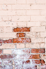 Vertical old red brick wall texture half painted