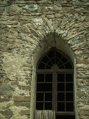 old stone castle wall with vertical windows