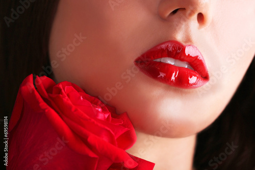 canvas print picture Woman's red lips and rose on dark background