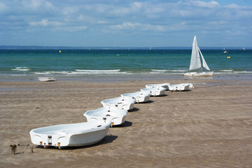 Row of small traing boats of a sail school in Brittany