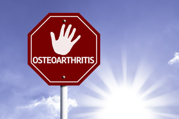Stop Osteoarthritis (OA) red sign with sun background