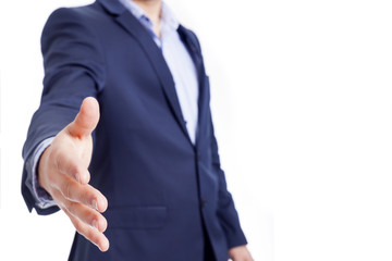 A business man with open hand for handshake, isolated on white