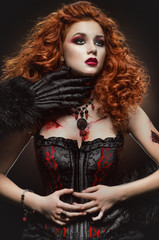 Gothic redhaired beauty and the beast
