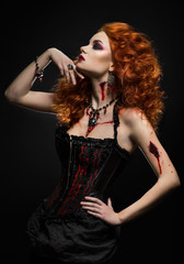 Gothic redhead beauty  with wounds