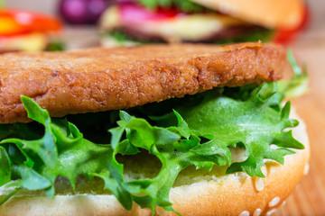 close up of hamburger on white plate