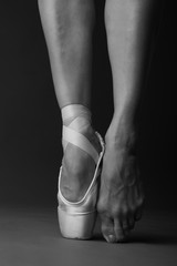 Standing on tip-toe, ballet dancer