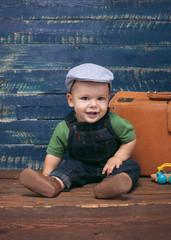 Baby boy on wooden background