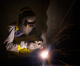 worker work hard with welding process poster