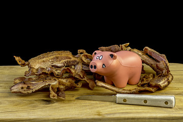 Pig stress ball with bacon and a knife
