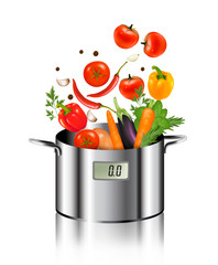 Vegetables falling into a pot. Healthy and diet food concept. Ve